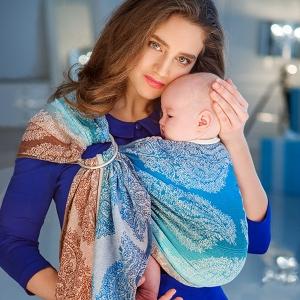 Как носить новорожденного в слинге?